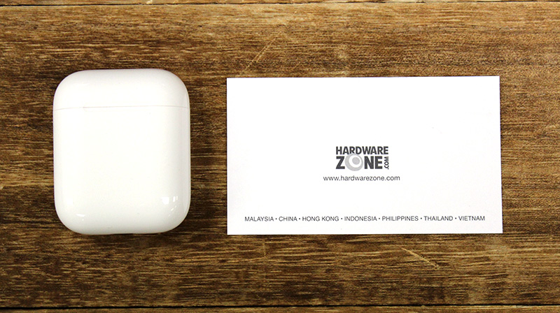 The charging case will slip into pockets easily. Here it is next to a namecard.