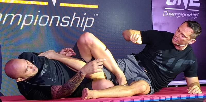 """Brandon """"The Truth"""" Vera and Rich """"Ace"""" Franklin demonstrating the basics of MMA fighting."""