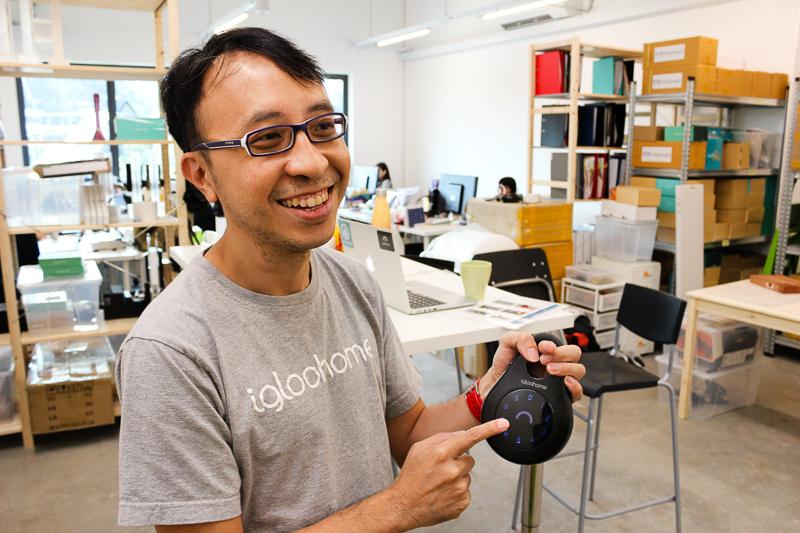 Kelvin Ho, Igloohome's CTO, holds up the company's smart lock box.