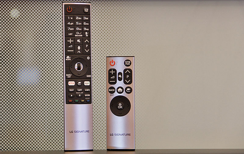 The Signature models' Magic Remote is styled a bit differently from the other models' Magic Remote. They also come with another shorter remote that has fewer keys.