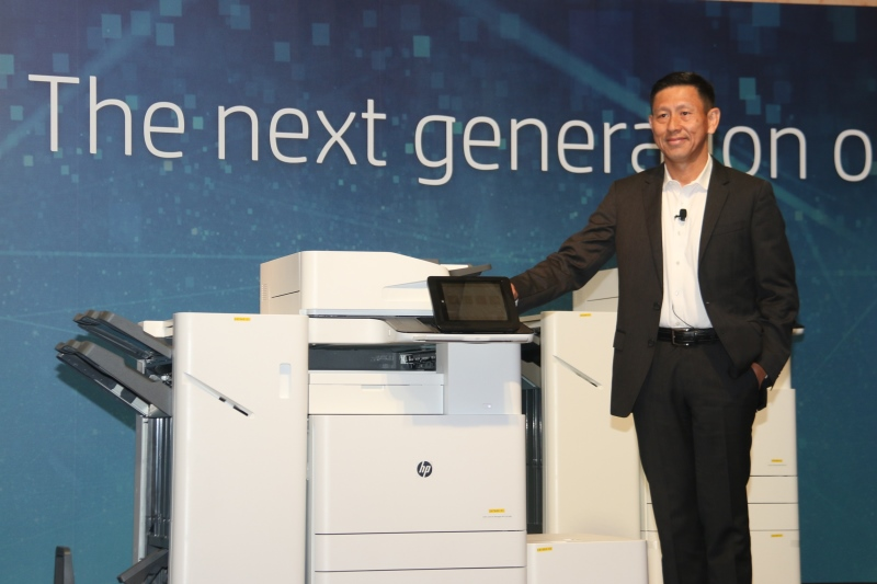 Ng Tian-Chong, General Manager, Printing Systems, HP Inc., Asia Pacific and Japan, with the new A3 printers.
