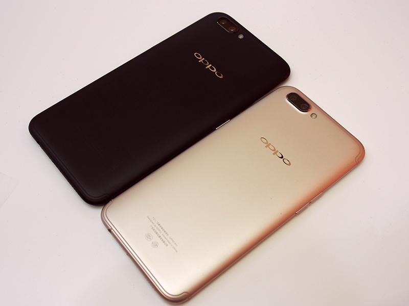 Oppo R11 Plus (Black) next to the regular R11 (Gold).