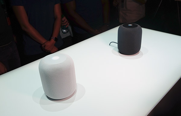 The new HomePod speakers come in black and white.