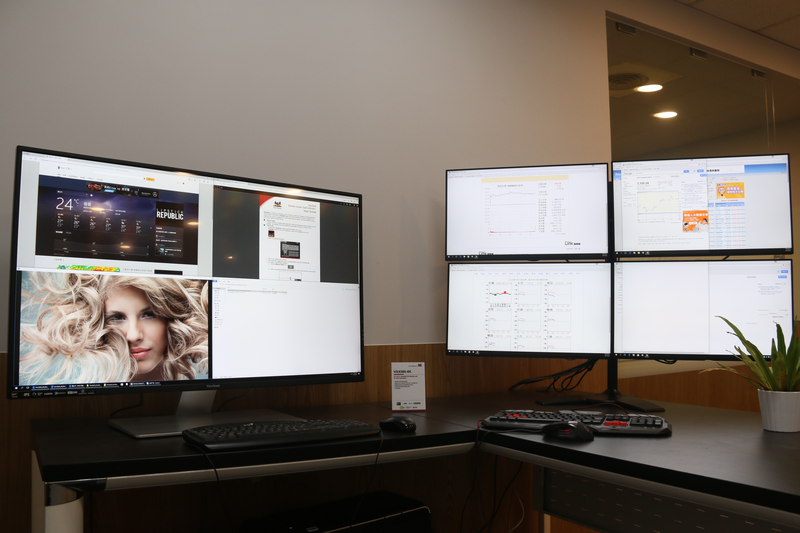 On the left, the VX4380-4K displays four Full HD video sources on one screen. To the right are four VP2468 monitors daisy-chained to achieve a similar result.