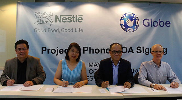 (L-R) Globe Business Vice President for Enterprise Sales Dion Asencio, Globe Senior Vice President for Corporate Communications Yoly Crisanto, Nestle' Philippines Senior Vice President for Corporate Affairs Ernie Mascenon and Nestle' Philippines Technical Director Peter Winter sign the Memorandum of Agreement for Globe Telecom and Nestle' Philippines' Project 1 Phone partnership