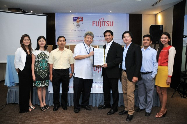 From left: Harriet B. Fernandez, Director, Computing and Information Services Office, Lennie K. Ong, University Treasurer, Edison B. Sasoy, Vice President for Administration, Fr. Roberto C. Yap, SJ, University President, Mr. Cricket Santiago, President and CEO of Fujitsu Philippines, Inc., Terry Ybanez, Sales Director, VisMin Business Unit, Sherwin Cortes, Solutions Architect, Joyce Punay, Account Manager, VisMin Sales Business Unit