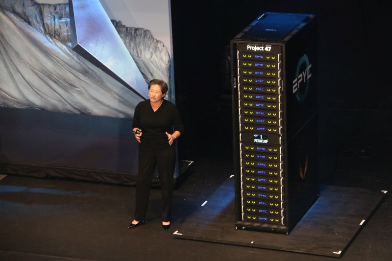 Dr. Lisa Su, CEO and President of AMD, standing next to Project 47, AMD's brand new workstation server comprised of a bunch of EPYC CPUs and Radeon Instinct GPUs.