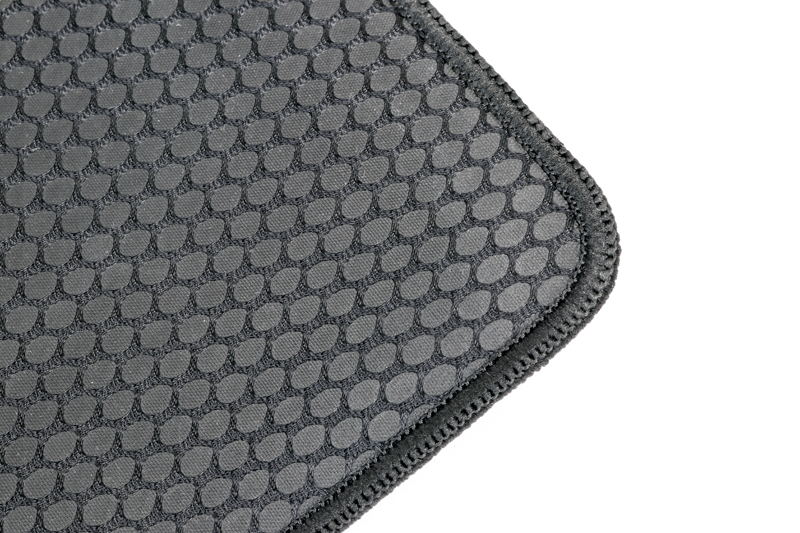 The texture of the HyperX Fury S' underside is similar to that of a lizard's grippy toe pads, which is a good thing. Also, look at that incredibly thick weave that runs along the sides of the Fury S to prevent fraying.