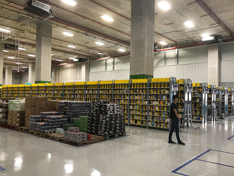 The Singapore Prime Now fulfillment facility spans 100,000 square feet. Items are randomly stowed based on forecasting of order frequency.