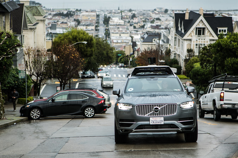 Uber testing its specially-converted self-driving Volvo XC90 SUV's on the streets of San Francisco in California. <br> Image source: Uber