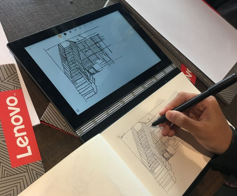 A participant using the dual-use Real Pen stylus to sketch, with ink.
