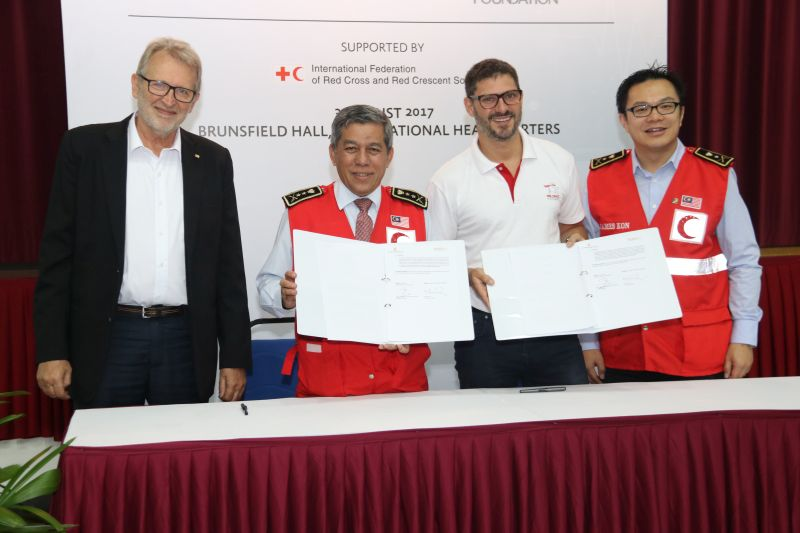 From L-R: Martin Faller, Deputy Director, IFRC Asia Pacific Zone (left); Dato' Sayed A. Rahman bin Sayed Mohd, MRCS Secretary General (second from left); and Marc Fancy, Executive Director, Prudence Foundation (second from right) during the signing of the MoU between the MRCS and the Prudence Foundation.