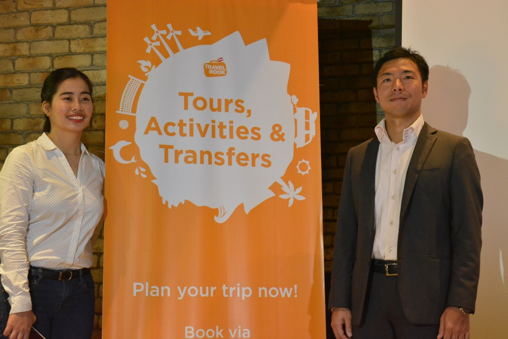 TravelBook.ph executives present at their launching event of the website's new offering Tours, Activities, Transfers: , Corporate Communications Manager Ms. Pinky Librada and General Manager Mr. Tazumi Nakazawa.