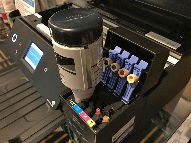 The ink only flows when the correct bottle is inserted into the correct ink tank - so no spills!