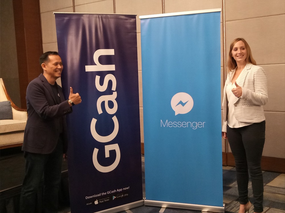 GCash President and CEO Albert Tinio and Facebook Product Lead for Mobile Financial Services Ginger Baker doing a singature 'thumbs-up' on the GCash and Messenger partnership launch.