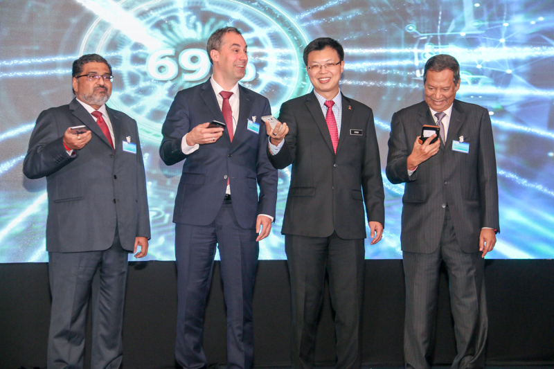 "From L-R: Datuk Prakash Chandran, President and Chief Executive Officer of Siemens Malaysia; Cedrik Neike, Siemens AG Managing Board Member, for Region Asia/Australia; and Datuk Chua Tee Yong, Deputy Minister, Ministry of International Trade and Industry; and Dato' Abdul Razak bin Abdul Majid, Chairman, Energy Commission; during the opening ceremony of the ""Shaping Digitalization -- Malaysia & Siemens: Our Journey Together"" conference earlier today."