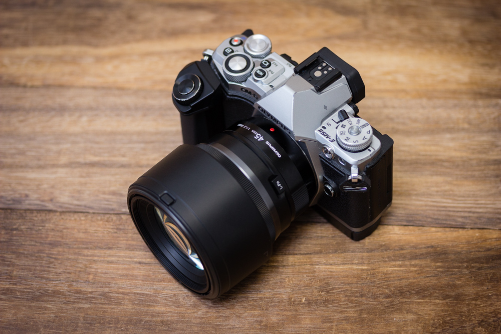 The 45mm f/1.2 Pro is quite a big lens, so you'll need a camera with a grip to balance its heft. Shown here on an Olympus E-M5 Mark II with its optional grip accessory and the lens hood attached.