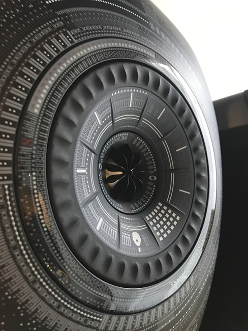 The patterns on the speaker actually represent sounds in the real world.