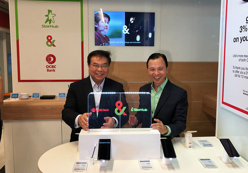 Mr Samuel Tsien, Group CEO of OCBC Bank, with Mr Tan Tong Hai, CEO of StarHub officially launch the new partnership.