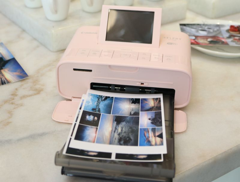 The pink variant of the SELPHY CP1300.