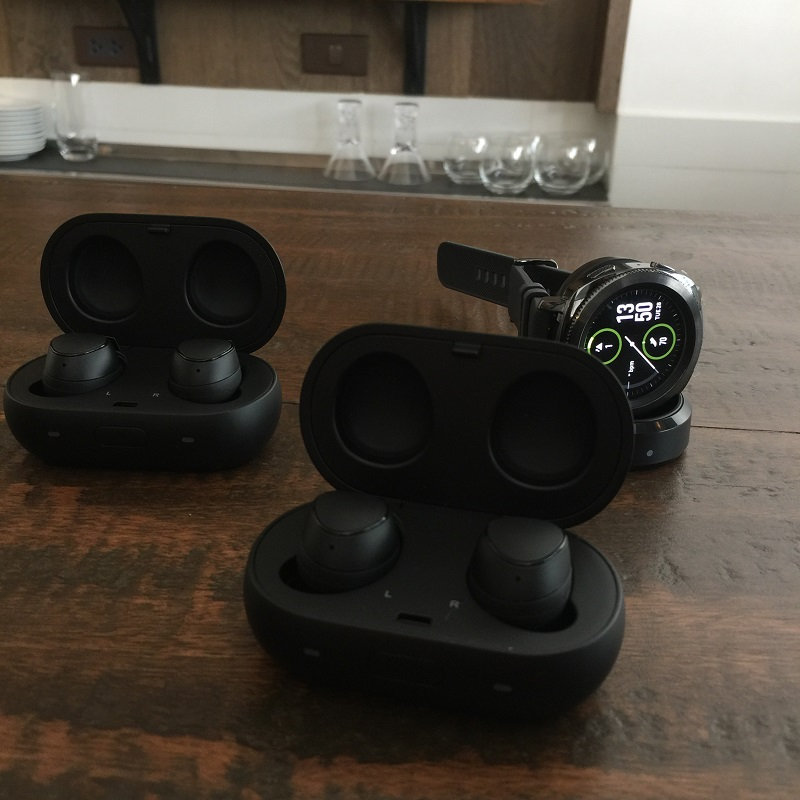 The Samsung Gear IconX in Black with the Samsung Gear Sport.