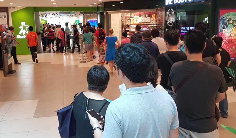 A queue of approximately 40 people for the iPhone X at StarHub's Plaza Singapura outlet. The shop doubles as a collection point.