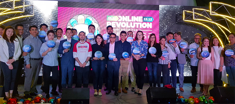 Lazada's Inanc Balci (in white and red shirt) with Lazada retail partners during the media launch of the Online Revolution Sale.