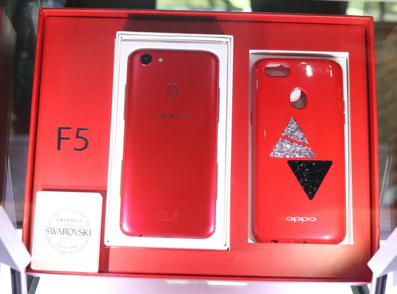 The limited edition red gift box, featuring the custom Swarovski crystal-embellished phone case.