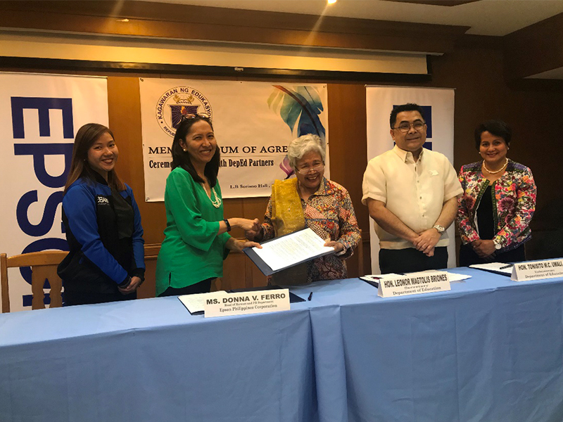 Epson Philippines formalized the company's commitment to equip less-privileged, deserving public schools with Epson technologies under the Gift of Brightness project. In the photo are DepEd Secretary Honorable Leonor Briones, Undersecretary Tonisito Umali, Director IV for External Partnership Services Margarita Ballesteros.  Signing for Epson Philippines is Marketing Communications and PR Head Donna V. Ferro, assisted by Epson Philippines PR Specialist Mica Bayot.