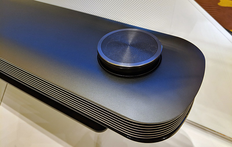 The W8P comes with a giant Dolby Atmos soundbar. All your I/Os, including HDMI 2.0 ports, are at the back of this speaker.