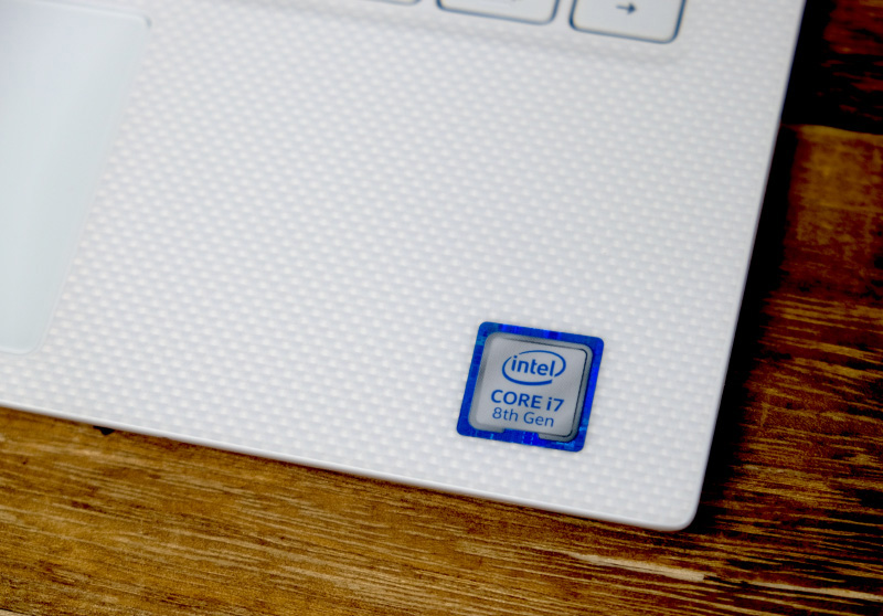 The rose gold model of the XPS 13 has a unique white woven glass fiber palm rest.