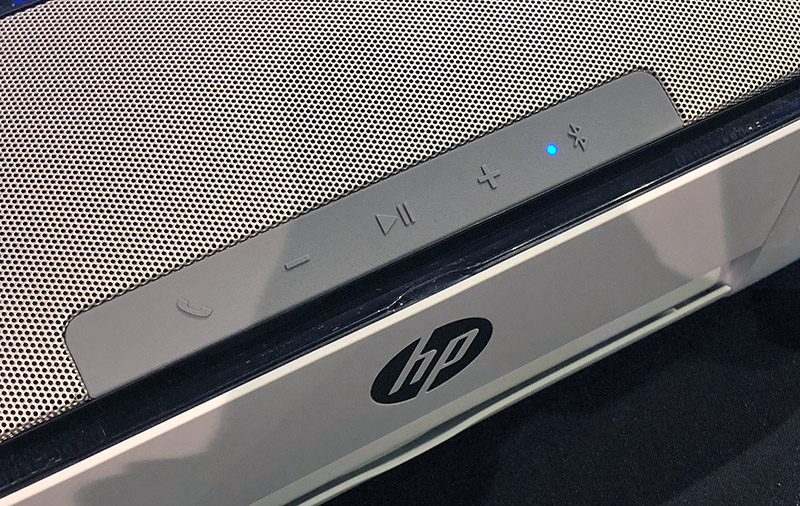 Call, volume, play/pause, and Bluetooth pairing buttons on top of the printer.
