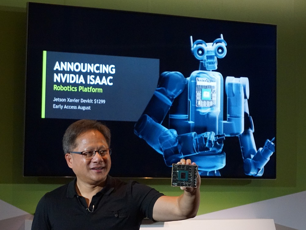 NVIDIA CEO Jensen Huang holding out the just introduced Jetson Xavier.