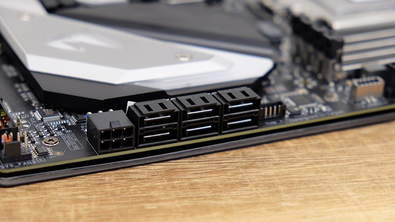 There's a 6-pin PCIe power connector beside the SATA ports to supply extra power to the GPUs.