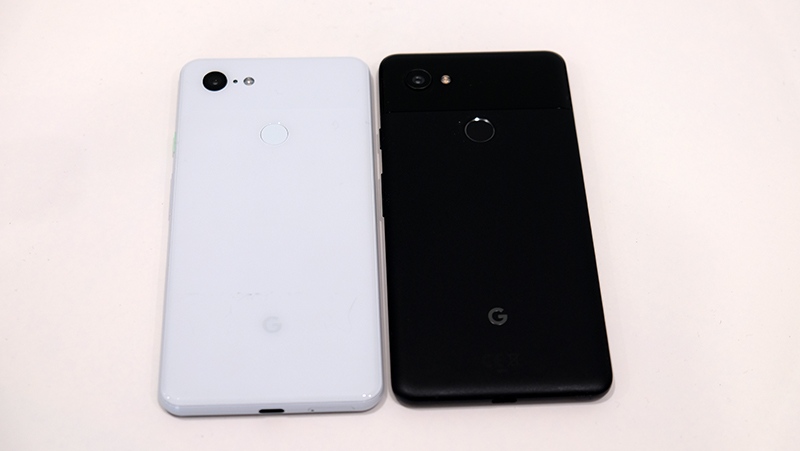 The Pixel 3 XL (white) beside the Pixel 2 XL (black).