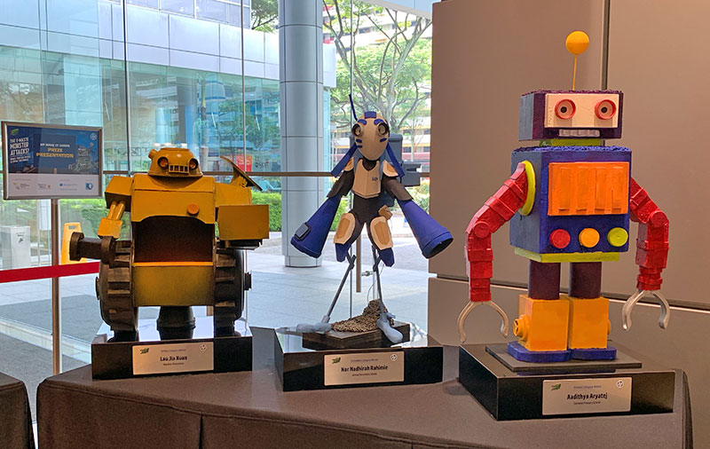 These are the awesome trophies for the primary, secondary, and tertiary student winners of the HP Make IT Green Campaign - Mech Robot Competition. Their drawings formed the blue print of the Mech Robot replicas, which are made from the remnants of old electronic devices.