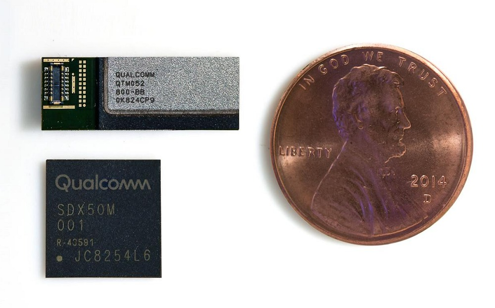 The QTM052 mmWave antenna module along with the Snapdragon X50 5G modem juxtaposed against a one penny coin.