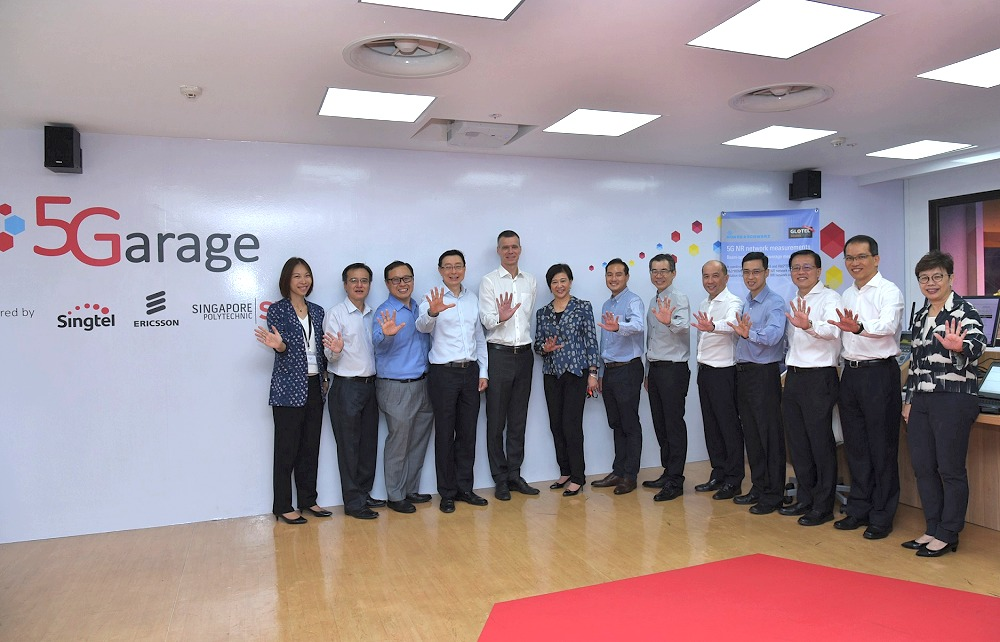 Chief Executive, IMDA, Mr Tan Kiat How and Singtel, Ericsson and Singapore Polytechnic management at the opening of 5G Garage, Singapore's first live 5G facility.