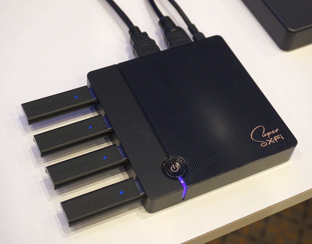 The SXFI TV box has dual HDMI ports (one in, one out), and four USB ports to take in up to four wireless USB dongles. That means you could pair it with up to four SXFI Theater headphones, with each person having their personalized mapped profile activated for best individual listening needs.