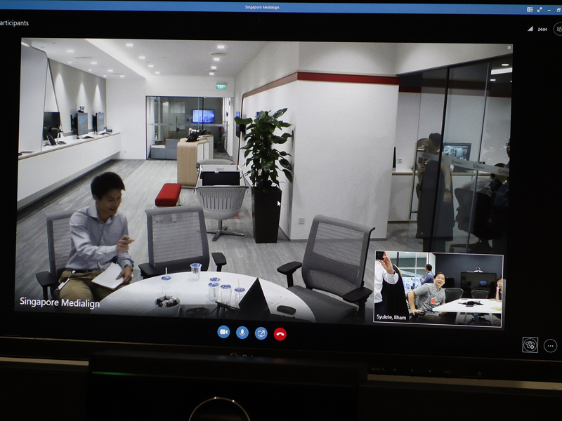 The inset video is due to the automatic group framing feature of Polycom Studio's camera.