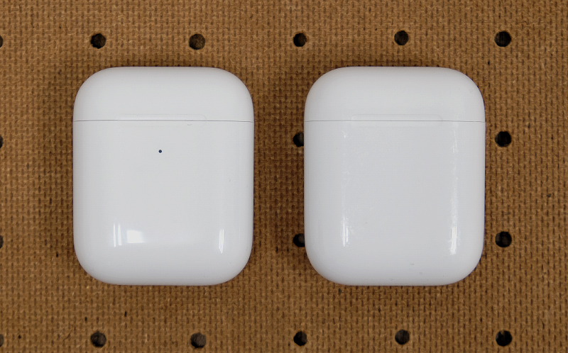 New wireless charging case on the left. It's distinguishable by the LED status indicator on the outside versus the previous version on the right.