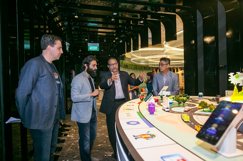 Google Cloud Managing Director (Asia Pacific), Rick Harshman (in foreground), and Developer Ecosystem Programme Manager, Sami Kizilbash, showing Minister S. Iswaran the Google Developer Space.