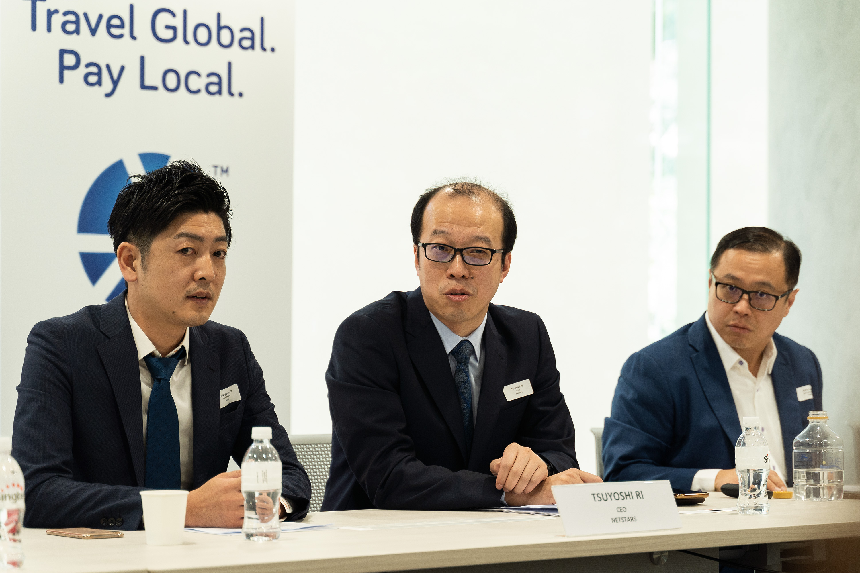 Mr Arthur Lang(right), CEO of Singtel's International Group, together with Mr Tsuyoshi Ri (middle), CEO, Netstars.