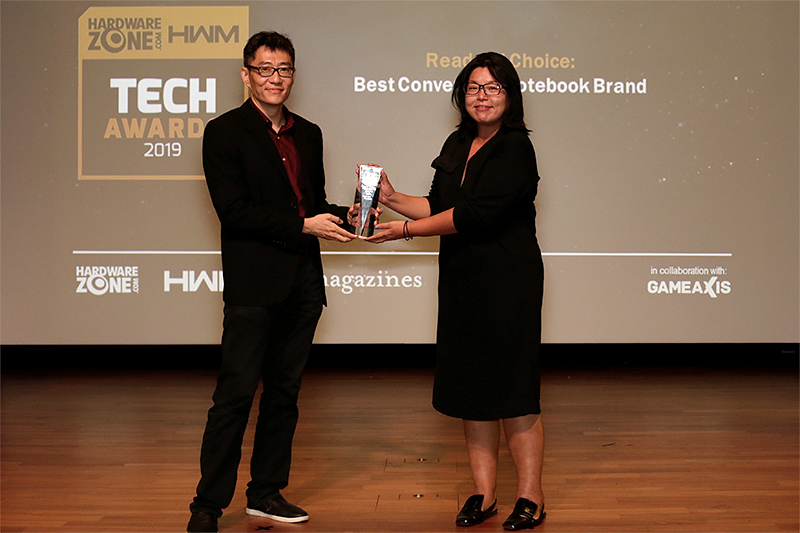 Microsoft wins the Readers' Choice for Best Convertible Notebook Brand. Here's Ms. Antonia Ong, Communications & Philanthropies Lead for Microsoft Singapore, accepting the award.