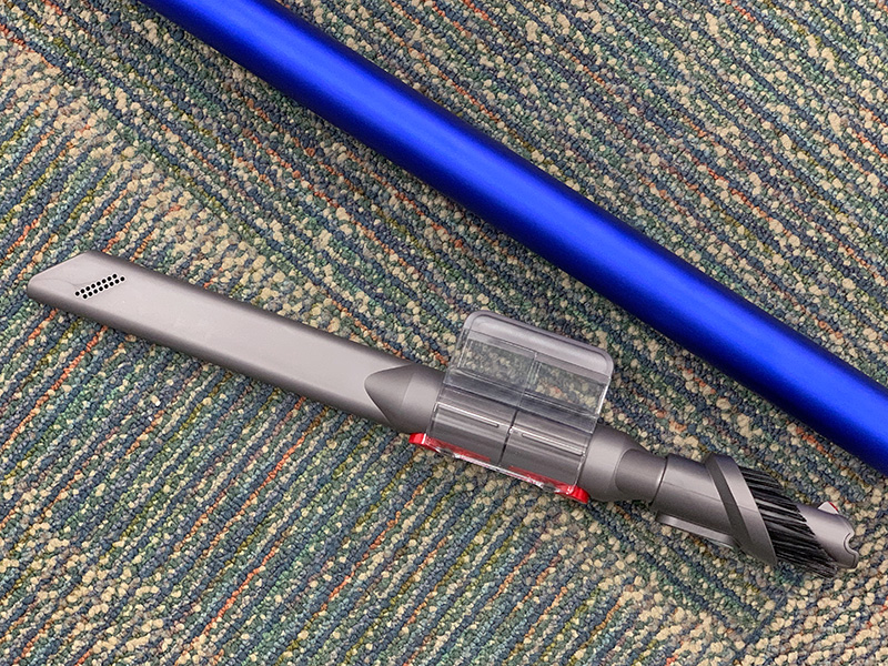There's a plastic clip that you can attach to the extension pole for holding the smaller tools and brushes.