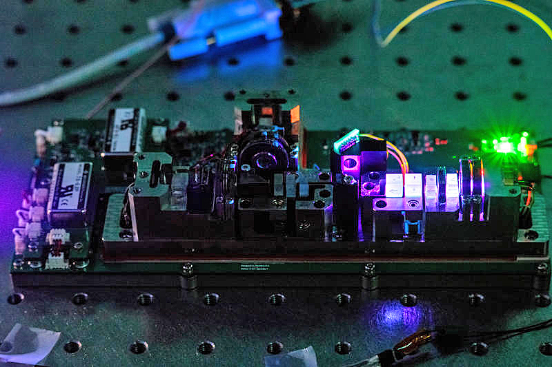 The instrument inside SpooQy-1 creates pairs of entangled light particles. Such light can be harnessed for secure communication. (Image source: Center for Quantum Technologies, National University of Singapore)