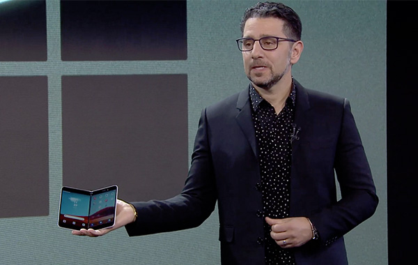 Microsoft's chief product officer Panos Panay holding the Surface Duo.