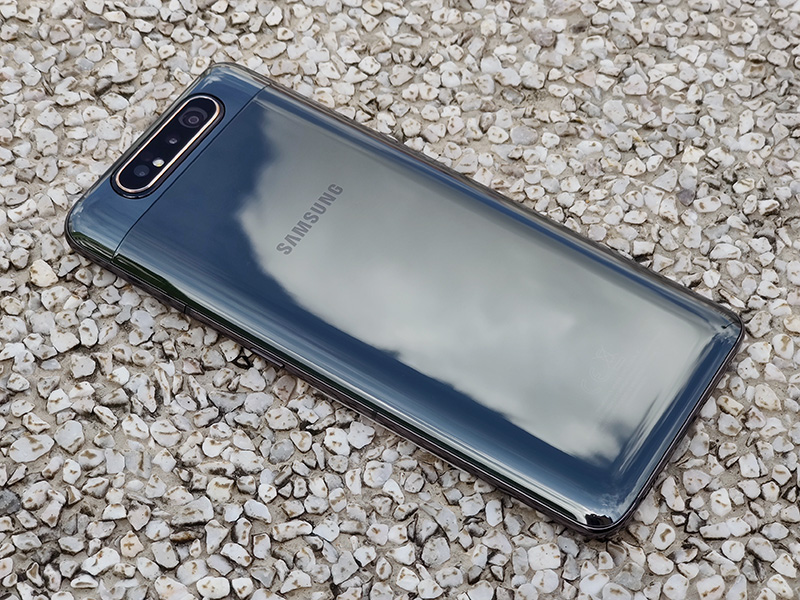 The Samsung Galaxy A80's perfectly curved edges and complete lack of any texture make it extremely slippery. Note also how the rear is devoid of any markings.