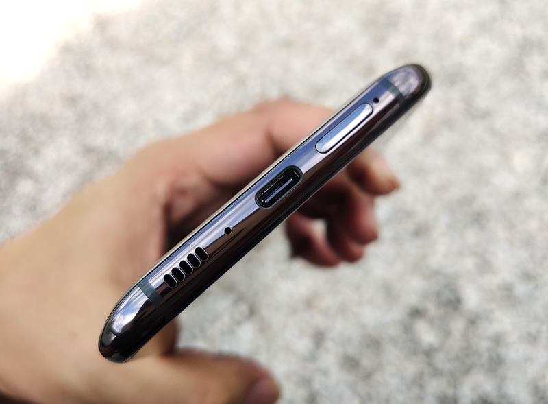 The Galaxy A80 charges via USB-C. It doesn't do wireless charging and it doesn't have a headphone jack.