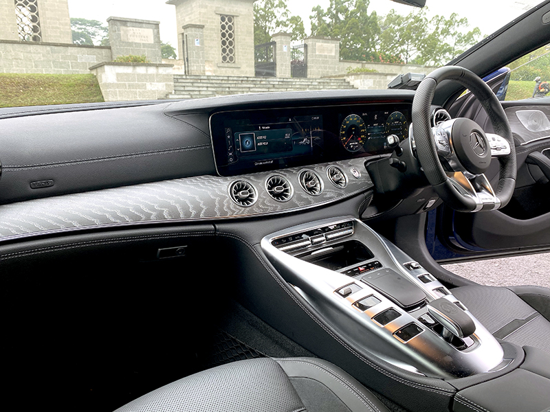 The cabin is sumptuous and modern. Note the two large digital displays forming most of the dashboard.